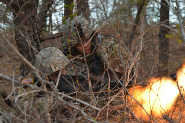 Soldiers from the 182nd Infantry Regiment, Massachusetts National Guard use scrub brush for concealment as they fire an M240 machine gun at a notional enemy during a training exercise at Joint Base Cape Cod, May 5, 2018. Over the course of four days, the Massachusetts Guard Soldiers conducted air assault raids using aviation assets provided by the New York National Guard. Massachusetts Army National Guard photo by SPC Samuel D. Keenan