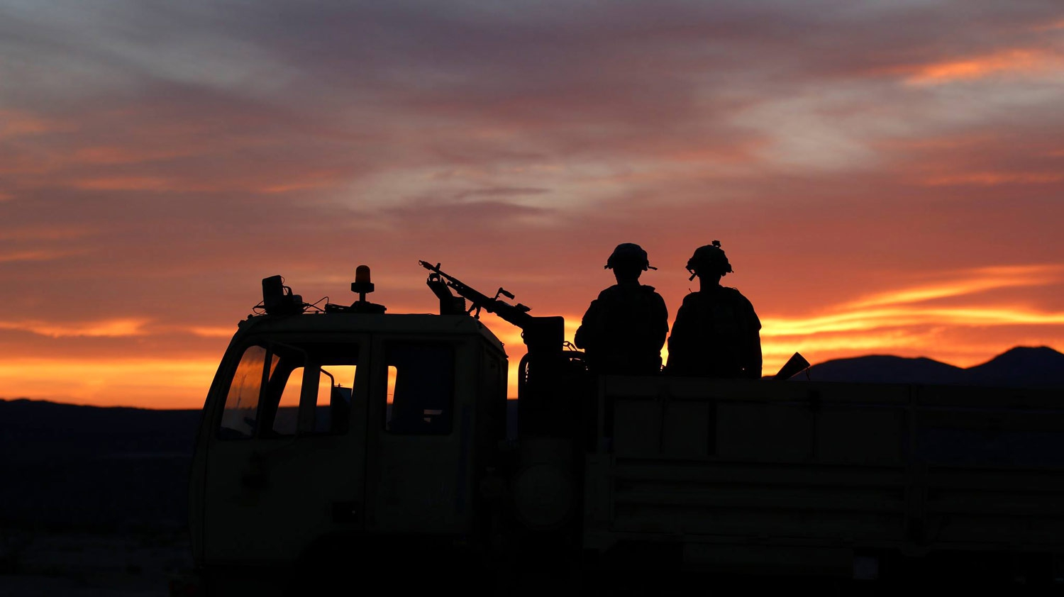SGT Seamus Redmond and SPC Joseph Page, members of Task Force Ragnar, stand guard during a rotation at the National Training Center in Fort Irwin, California, May 8, 2018. Led by the Minnesota Army National Guard, Task Force Ragnar is made up by Soldiers from Utah-based B Company, 1st Battalion, 211th Assault Reconnaissance Battalion; Nevada-based B Company, 1-189th General Support Aviation Battalion; Michigan-based C Company, 3-238th GSAB; and Minnesota-based A, D, E and Headquarters Companies, 2-147th AHB and F Company, 1-189th GSAB. Minnesota Army National Guard photo by CPT Katherine Zins