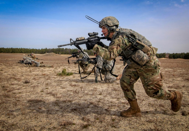 New Jersey Army National Guard Soldiers from Charlie Company, 1st Battalion, 114th Infantry (Air Assault), bound towards a target during live-fire battle drills on Joint Base McGuire-Dix-Lakehurst, N.J., April 9, 2018. New Jersey Air National Guard photo by MSgt Matt Hecht