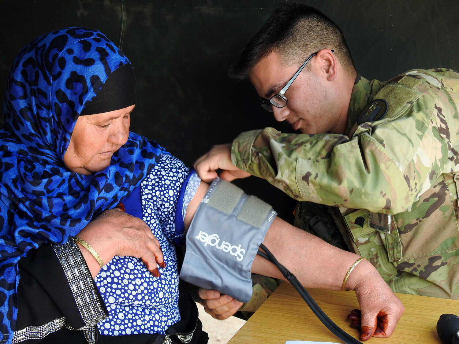 SPC Nathan Ro of the Utah Army National Guard's Medical Command checks the blood pressure of a Moroccan citizen during Exercise African Lion 2018, April 15–April 28. The overseas deployment training was a joint initiative between the armed forces of the United States, Morocco, Tunisia, Canada and six European nations. The annually scheduled exercise involves various types of training and maneuvers held throughout Morocco. The Utah Army National Guard was responsible for the exercise's Humanitarian and Civic Assistance event. Utah Army National Guard photo by MAJ Samantha Madsen