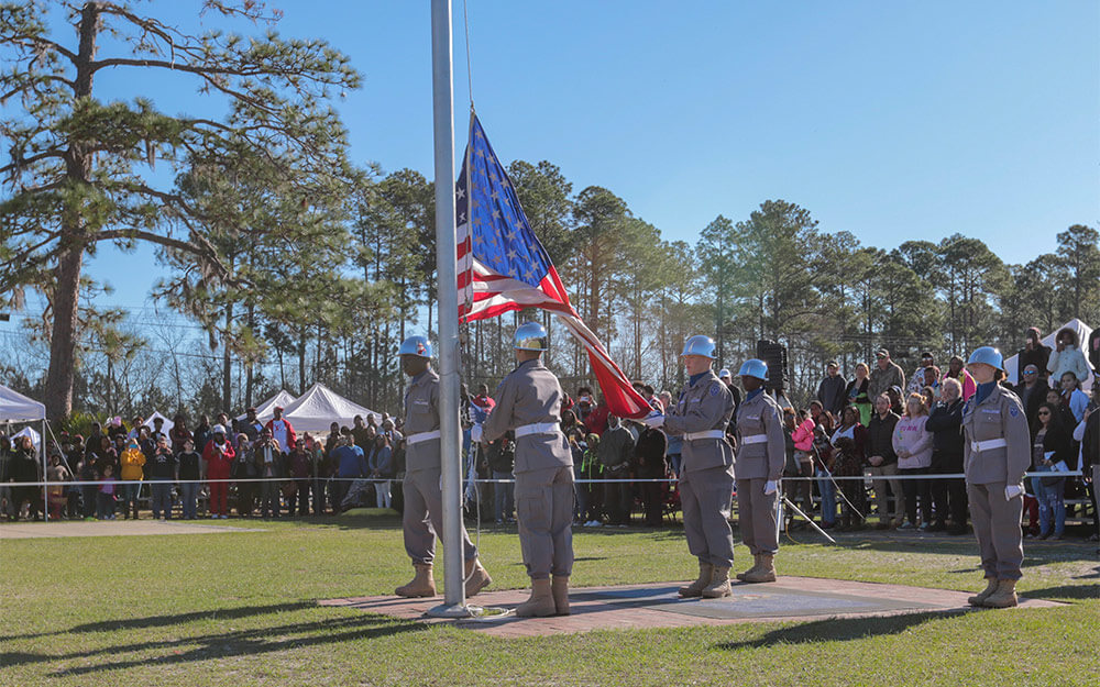 Students from the Georgia National Guard Youth ChalleNGe Academy's Color Guard raise the U.S. Flag during the academy's Family Day. Georgia Army National Guard photo by SSG R.J. Lannom Jr.