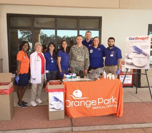 "CPT Michael Coy with the Florida National Guard's Counterdrug Program works with Orange Park Medical Center staff members during a ""Take Back"" event in Orange Park, Fla. Image courtesy Florida National Guard"