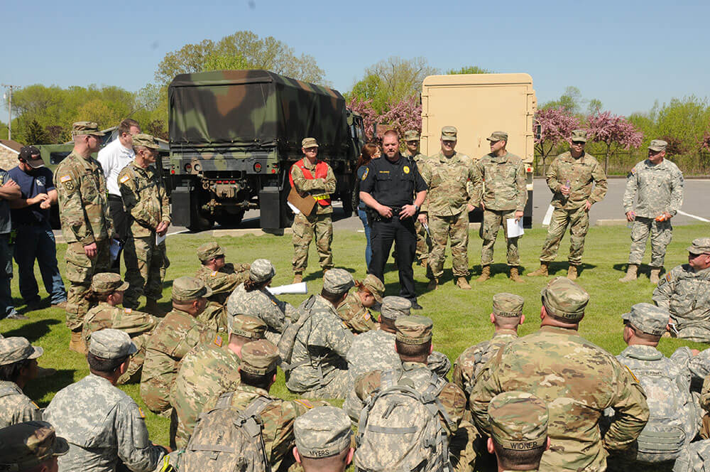 Omro, Wis., Police Chief Joe Schuster briefs Wisconsin National Guard Soldiers and other local and State first responders before they begin a canvassing operation in Omro as part of the Dark Sky training exercise. Wisconsin Army National Guard photo by SSG Matthew Ard