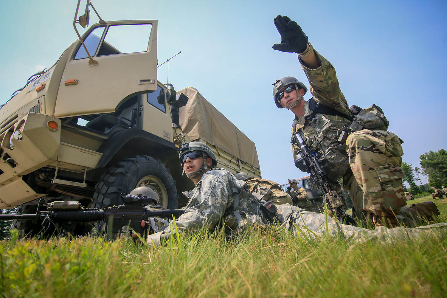 Army National Guard 1LT Robert Angelini (right) from New Jersey's C Troop, 1st Squadron, 102nd Cavalry Regiment, points out enemy locations to fellow Soldiers during a training mission on Joint Base McGuire-Dix-Lakehurst, N.J. New Jersey National Guard photo by MSgt Matt Hecht