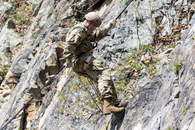 CW2 David Morton, range operations manager at Camp Smith, assigned to the 42nd Infantry Division, New York Army National Guard, navigates the terrain of a mountainside using one of the newly updated rappel lanes at Camp Smith Training Site in Cortlandt Manor, N.Y. New York Army National Guard photo by SSG Michael Davis