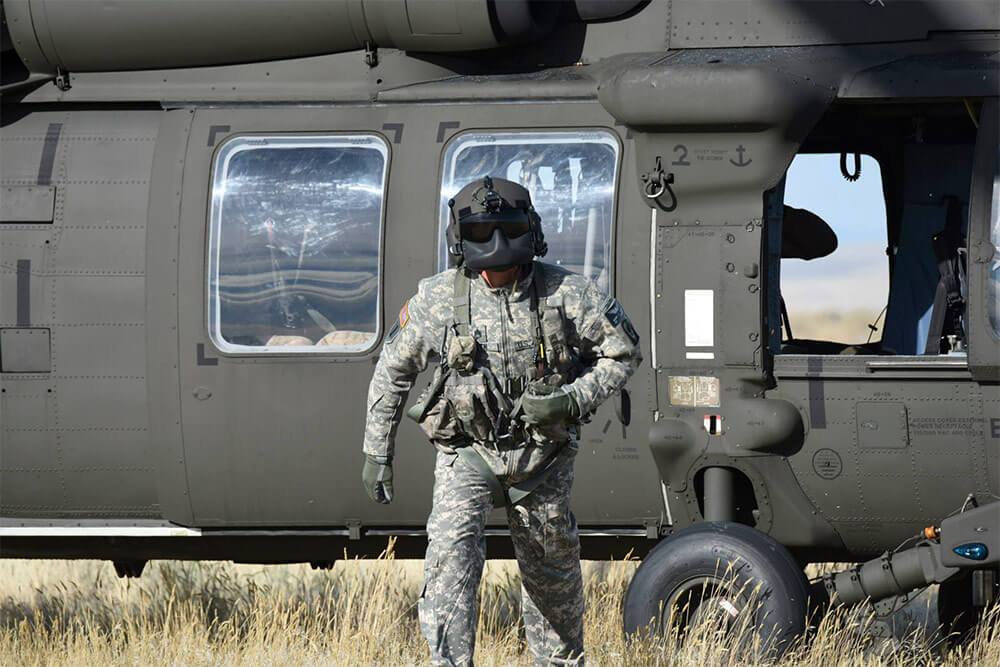 SSG Albert Vieth exits his UH-60 Black Hawk during a training exercise in the spring of 2015 at the Salyor Creek Range near Mountain Home, Idaho. Photo courtesy SSG Albert Vieth