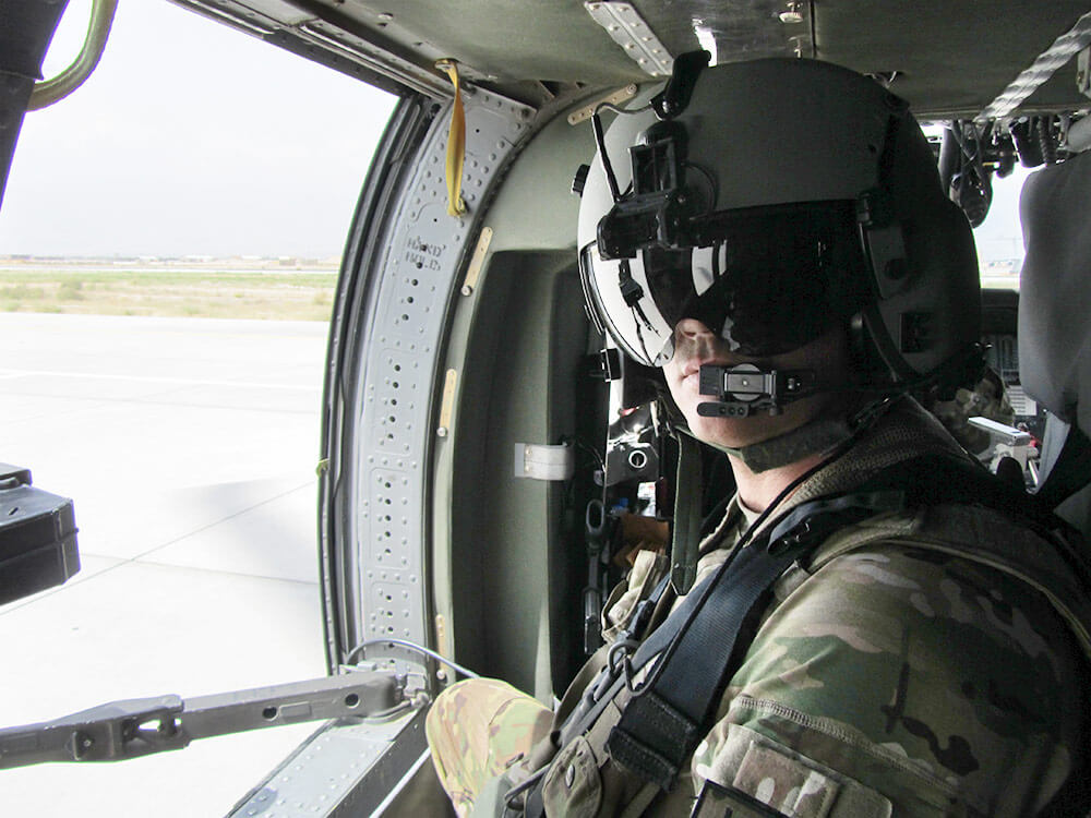 SSG Albert Vieth prepares for takeoff inside his UH-60 Black Hawk prior to A Company, 1-168th General Support Aviation Battalion's aerial gunnery training at Gowen Field, Boise, Idaho. Photo courtesy SSG Albert Vieth