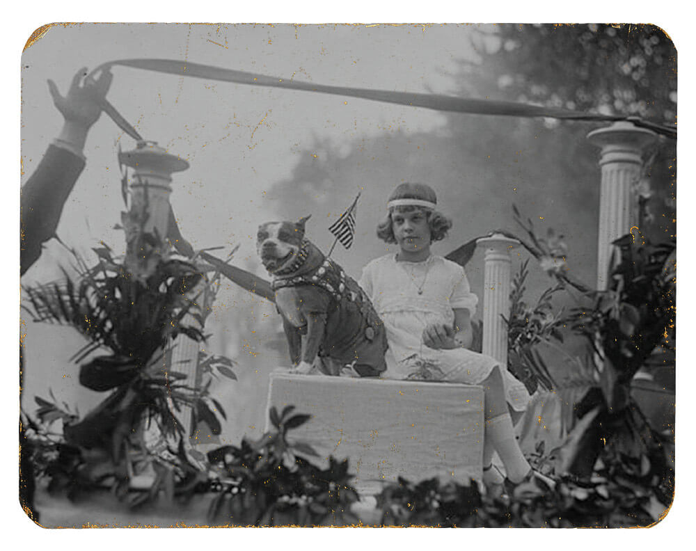 SGT Stubby rides a float with a little girl, Louise Johnson, during an animal parade held in Washington, D.C., May 1921. Photo courtesy Library of Congress, Harris and Ewing Collection