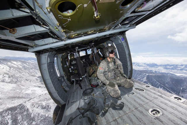 SGT Vincent Lindelin, Colorado Army National Guard, sits in the back of a military helicopter while participating in a High-Altitude Army National Guard Aviation Training Site (HAATS) course. Run by full-time Colorado Army National Guard pilots, HAATS is specifically designed to train military rotary-wing pilots and offers a unique training methodology based on aircraft power that is designed to dramatically increase individual and crew situational awareness. Photo courtesy Frank Crebas