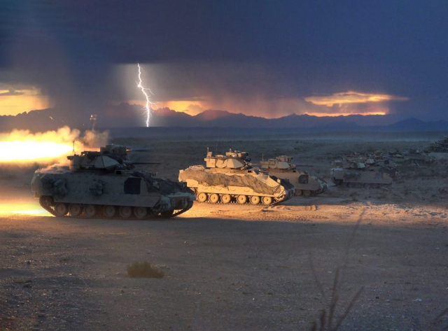 Lightning strikes as Bradley Fighting Vehicles from the 1st Battalion, 150th Cavalry Regiment of the 30th Armored Brigade Combat Team, fire tube-launched, optically tracked, wire-guided (TOW) missiles during a Combined Arms Live Fire Exercise (CALFEX) at Fort Bliss, Texas, in August 2018. This CALFEX is part of the Army National Guard's eXportable Combat Training Capability program, an instrumented brigade field training exercise designed to certify platoon proficiency in coordination with First Army. North Carolina Army National Guard Photo by SSG Brendan Stephens