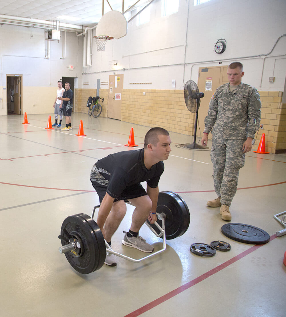 SSG David Immler, a recruiting and retention noncommissioned officer with the Missouri National Guard Recruiting and Retention Battalion, measures a recruit's performance during the strength deadlift – one of four events included in the Occupational Physical Assessment Test. Missouri Army National Guard photo by CPL Samantha J. Whitehead