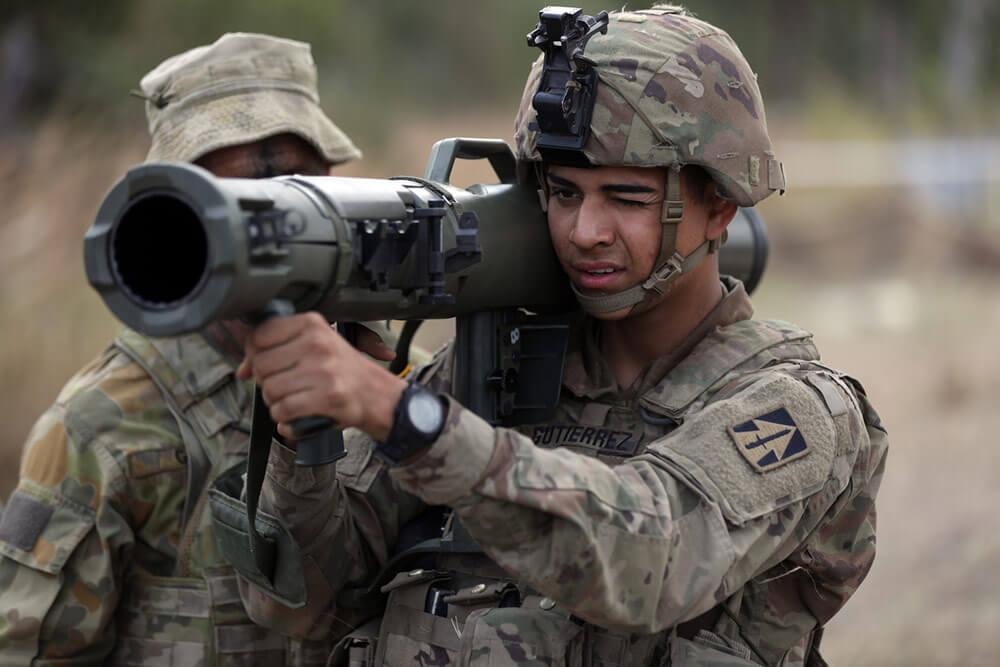 PFC William of Charlie Company, 1st Battalion, 293rd Infantry Regiment, Indiana Army National Guard, works with an Australian Defence Force soldier on the operation of the M4 84 mm Carl Gustav Recoilless Rifle during a training scenario held as part of 2018's Exercise Hamel at Shoalwater Bay Training Area, Australia. U.S. Army photo by SSG Keith Anderson