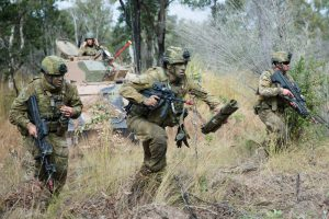 Australian Defence Force soldiers from Battlegroup War Horse take part in a notional assault on Williamson Airfield in the Shoalwater Bay Training Area, as part of Exercise Hamel, June 2018. Australian Defence Force photo by Capt. Roger Brennan