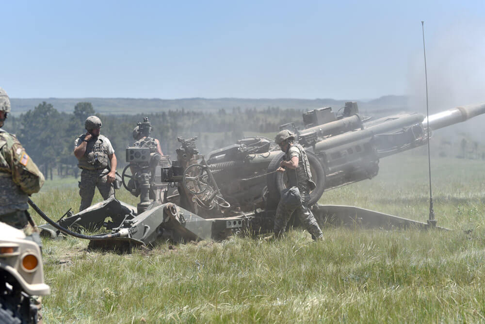 A group of Soldiers from the 1st Battalion, 117th Field Artillery Regiment, Alabama Army National Guard – which is assigned to the 142nd Field Artillery Brigade – prepare to fire an M777 Towed Howitzer during Operation Western Strike 2018 at Camp Guernsey, Wyo. Arkansas Army National Guard Photo by SSG Kelvin Green