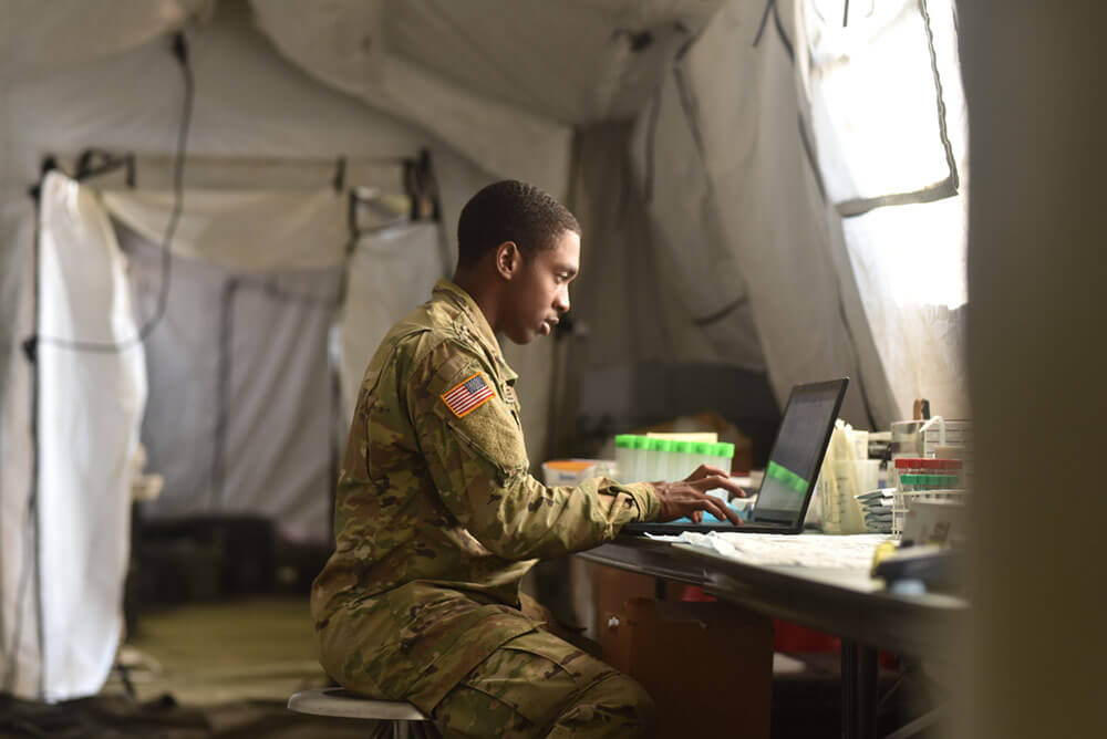 SGT Dakori Lee of the 213th Area Support Medical Company keys in patient information after giving a medical exam during field training held as part of the 2018 Operation Western Strike. Arkansas Army National Guard Photo by SSG Kelvin Green
