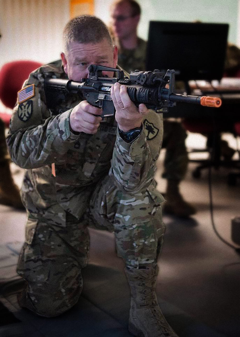 A South Carolina Army National Guard Soldier with the Marksmanship Training Unit demonstrates how to use the Mobile Marksmanship Training Simulator to Soldiers of the 108th Public Affairs Detachment while training at the Bluff Road Armory, Columbia, S.C., in May of 2018. South Carolina Army National Guard photo by SSG Jerry Boffen