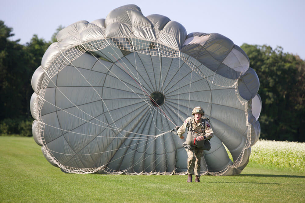 A British Paratrooper runs toward the X-mark after landing in the Castle Drop as part of Leapfest 2018. U.S. Army photo by SSG Austin Berner