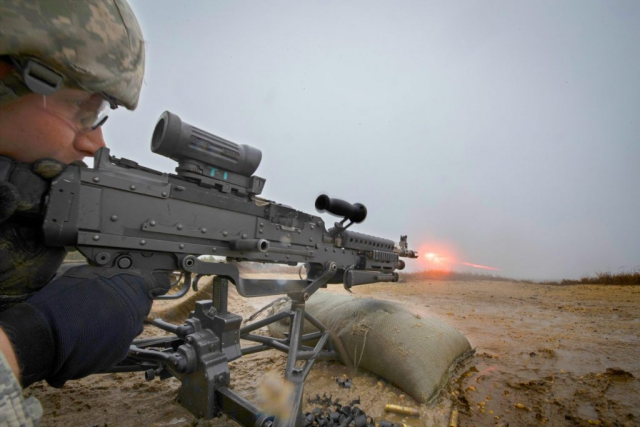 CPL Brandon Chadwick, 44th Infantry Brigade Combat Team, A Company, 1-114th Infantry Regiment, New Jersey Army National Guard, fires a M240 machine gun during weapons training on Joint Base McGuire-Dix-Lakehurst, N.J., in November of 2018. New Jersey National Guard photo by MSgt Matt Hecht