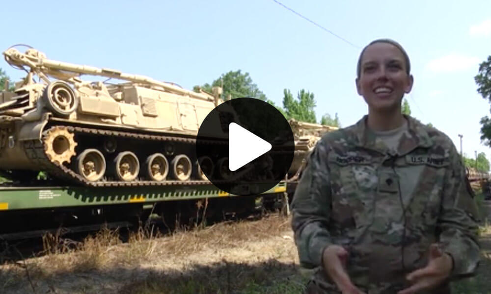 In support of Operation Western Strike Crewmembers of the 142nd Field Artillery Brigade, Arkansas National Guard, load tracked armored vehicles onto railcars for the first time since Operation Desert Storm. (U.S. Army National Guard video by Staff Sgt. James Heuston)