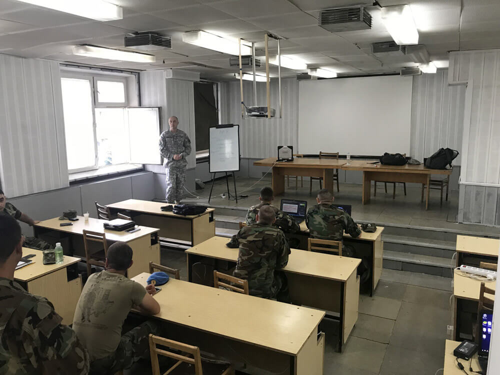 CW4 Donald Champion leads members of the Moldovan Armed Forces communications staff through a table-top training scenario as part of cyber defense training in Chisinau, Moldova, July 2018.
