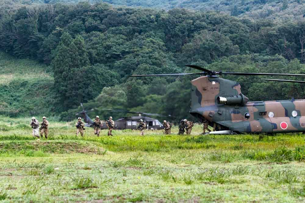 Soldiers of the Indiana National Guard's 76th Infantry Brigade Combat Team maneuver from a Japanese helicopter Chinook during a training assault as part of Exercise Orient Shield 2018 held at Ojojihara Maneuver Area, Japan.