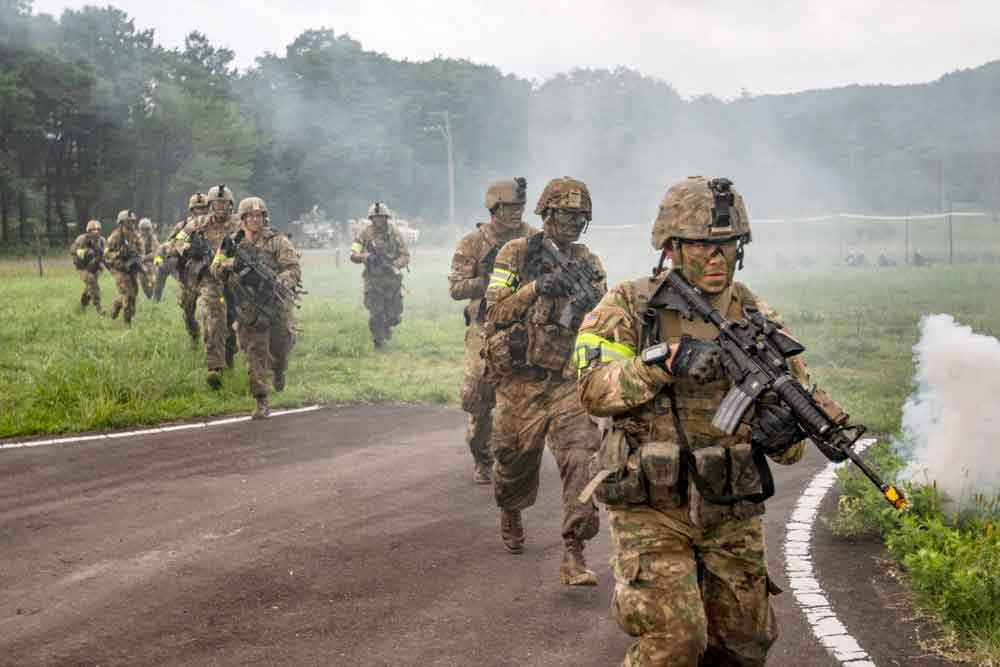 Indiana Soldiers of the 76th Infantry Brigade Combat Team advance on an objective during a notional assault as part of Exercise Orient Shield, an annual tactical field training co-led by U.S. Army Pacific Command and the Japan Ground Self-Defense Force.