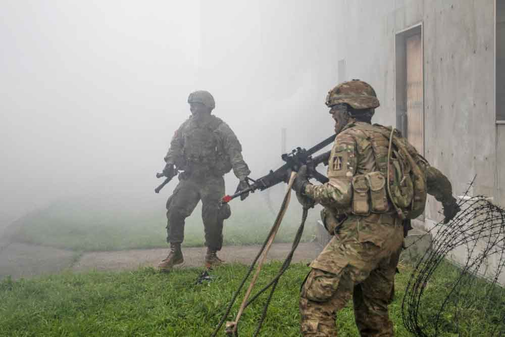 Soldiers of the Indiana Army National Guard's 76th Infantry Brigade Combat Team rehearse clearing techniques at Ojojihara Maneuver Area, Japan, as part of a simulated ground assault during Exercise Orient Shield 2018, a bilateral tactical field training under the larger regional event Pacific Pathways.