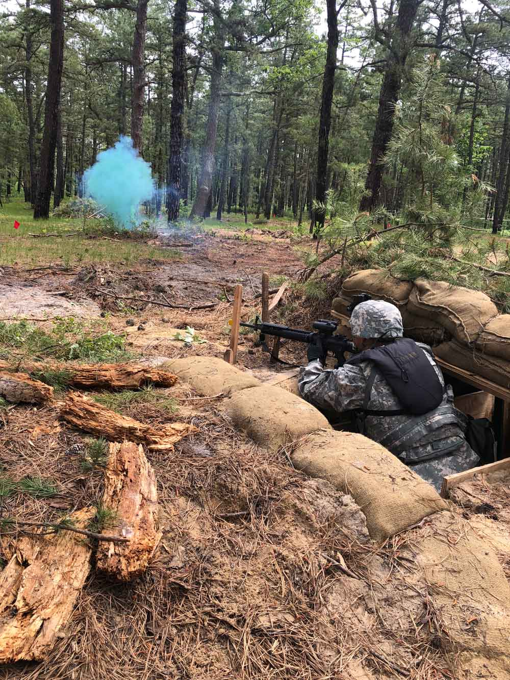 A New Jersey Army National Guard Soldier with the 350th Financial Management Support Detachment provides suppressive fire during a live fire drill held as part of the unit's mobilization exercise conducted May-June 2018 at Joint Base McGuire-Dix-Lakehurst.