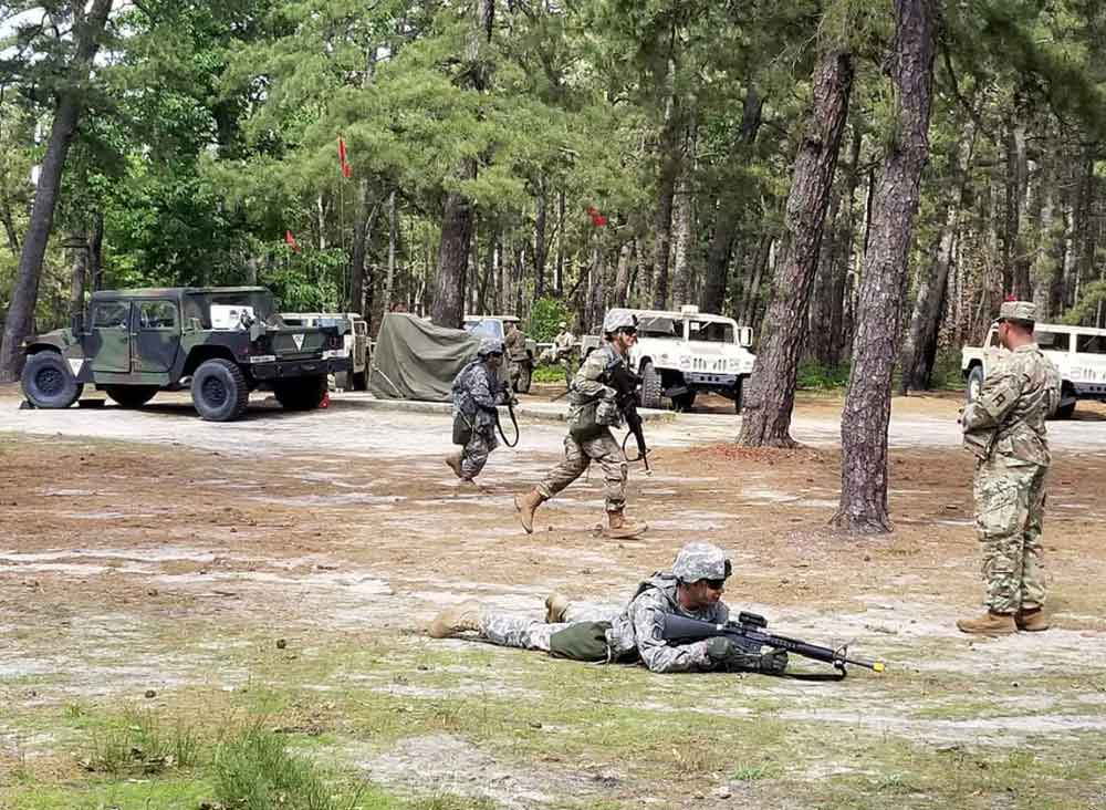 Soldiers of the 350th Financial Management Support Detachment rehearse bounding and 3- to 5-second rushes during a two-week mobilization exercise at Joint Base McGuire-Dix-Lakehurst.