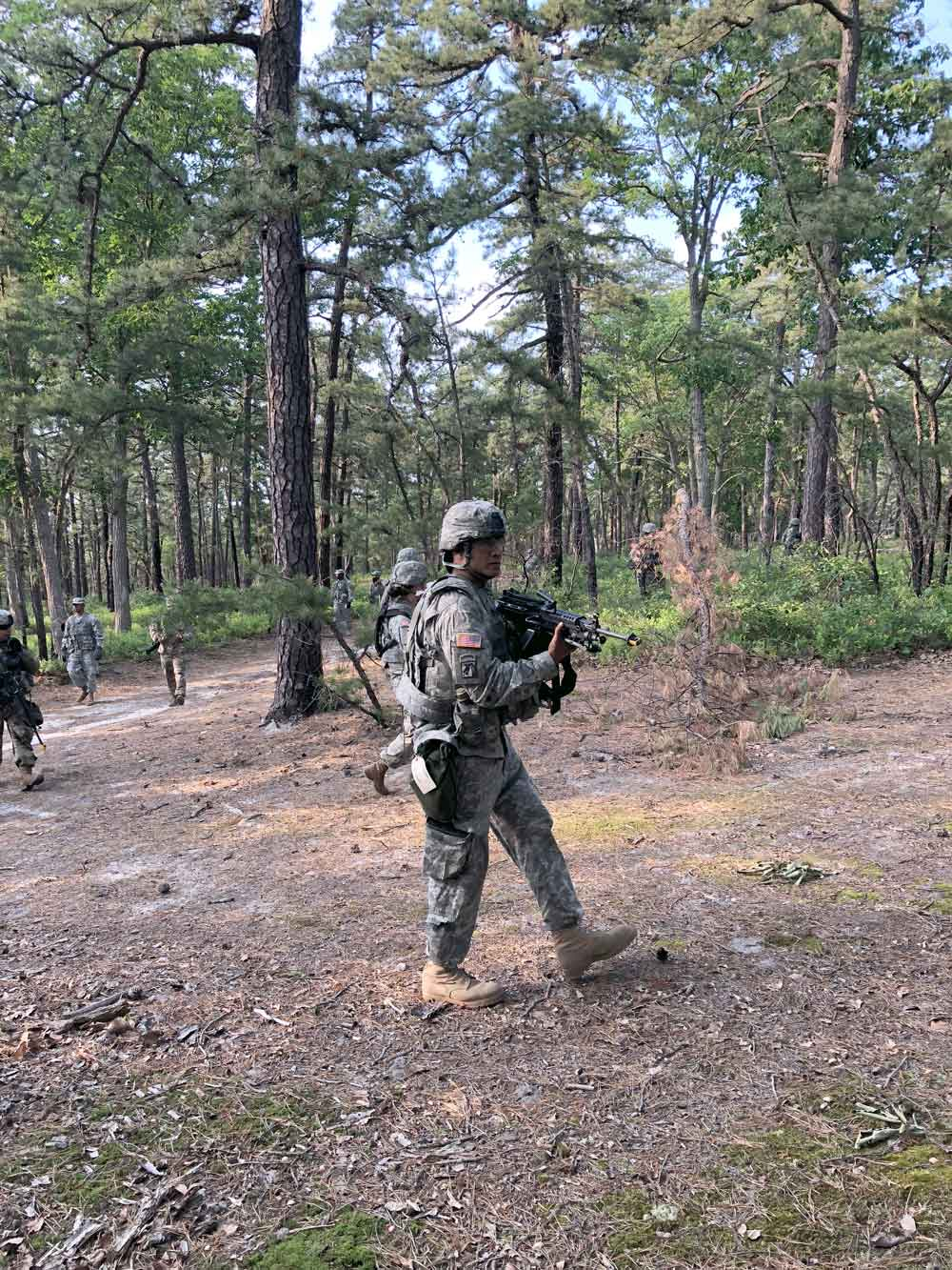 SFC John Vasquez conducts patrols during a dismounted situational training lane conducted as part of the 350th Financial Management Support Detachment's training at Joint Base McGuire-Dix-Lakehurst.