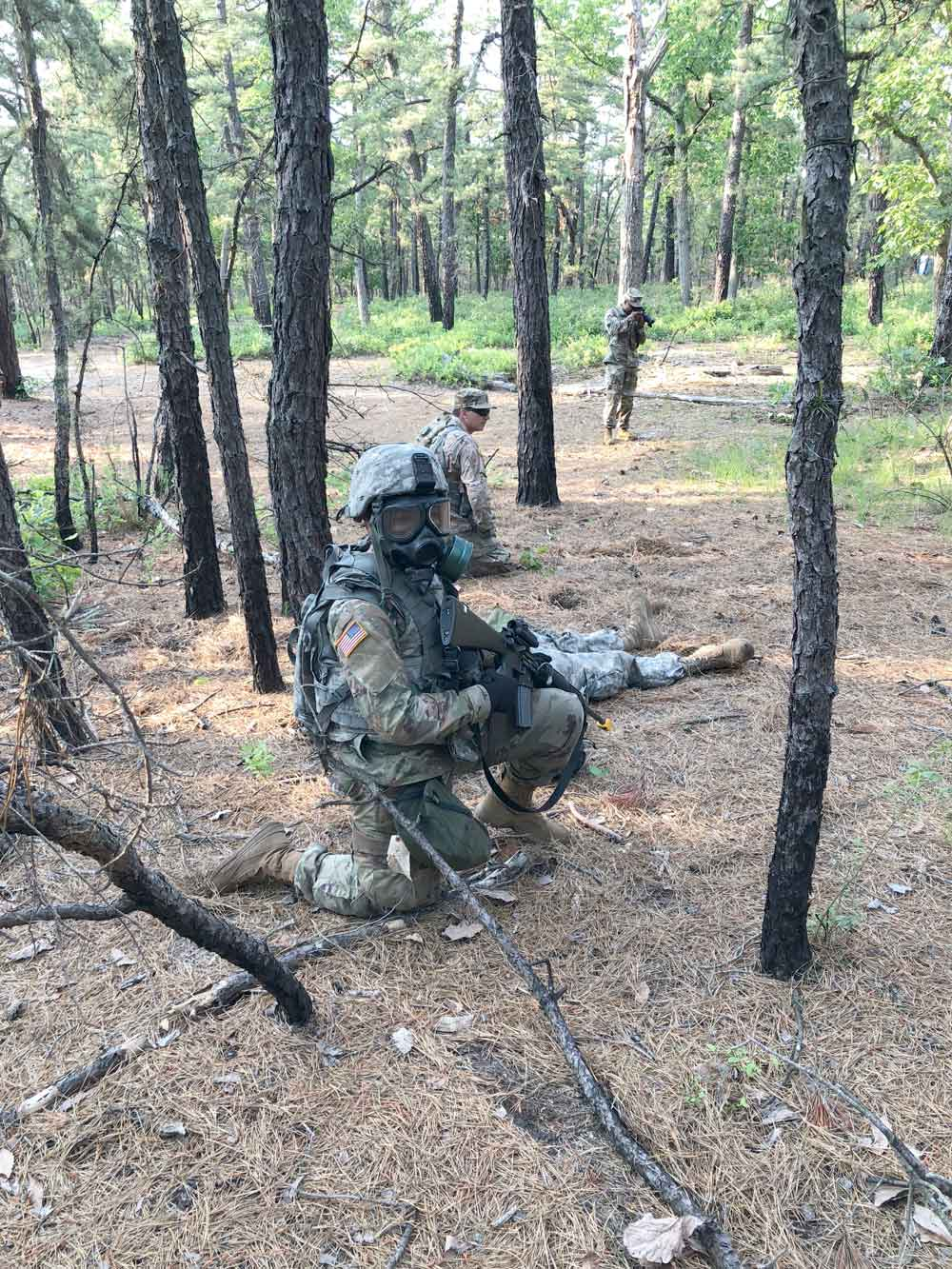 2LT Katty Vellida waits for an all-clear while rehearsing nuclear, biological, chemical attack procedures during the 350th Financial Management Support Detachment's mobilization exercise.