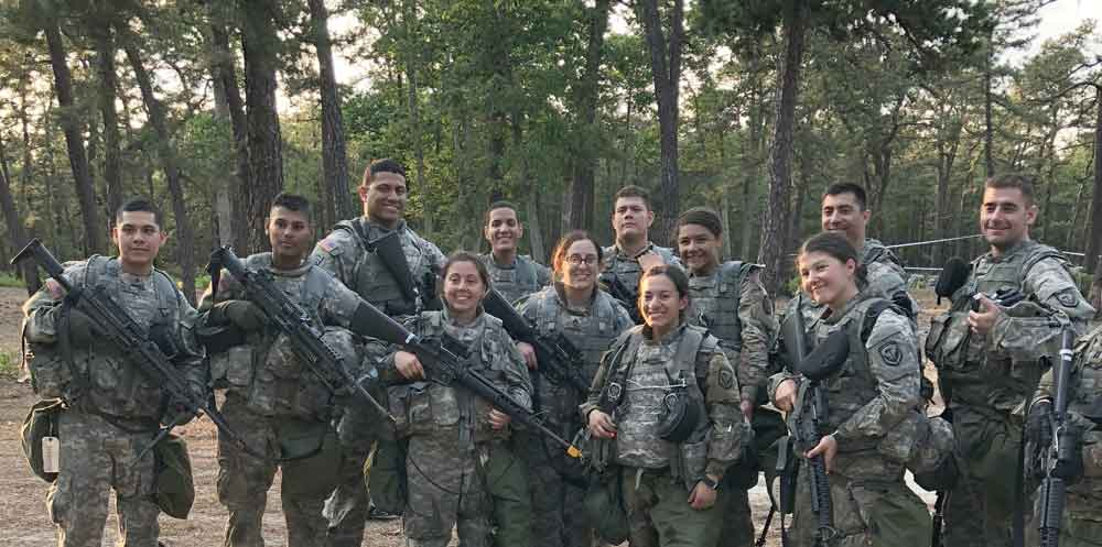 Soldiers of 250th Financial Management Support Detachment pose for a group photo after a day of training at Joint Base McGuire-Dix-Lakehurst.