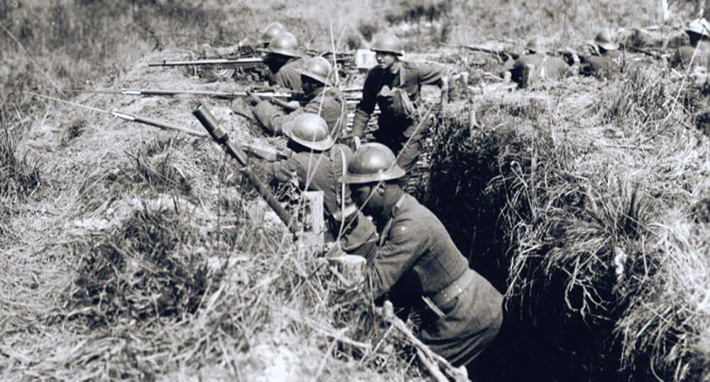 Soldiers of the 369th Infantry Regiment, New York Army National Guard man a WWI trench on the battlefield in France. Courtesy photo