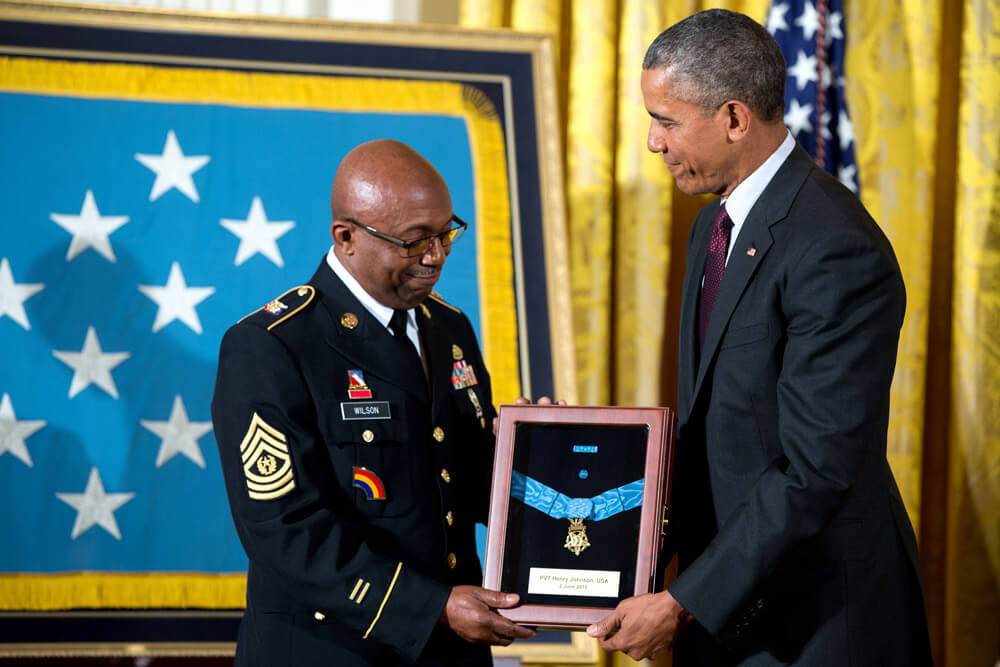 President Barack Obama awards the Medal of Honor posthumously to PVT Henry Johnson for conspicuous gallantry during World War I, at a ceremony in the East Room of the White House, June 2, 2015. CSM Louis Wilson accepts the Medal of Honor. Official White House photo by Pete Souza