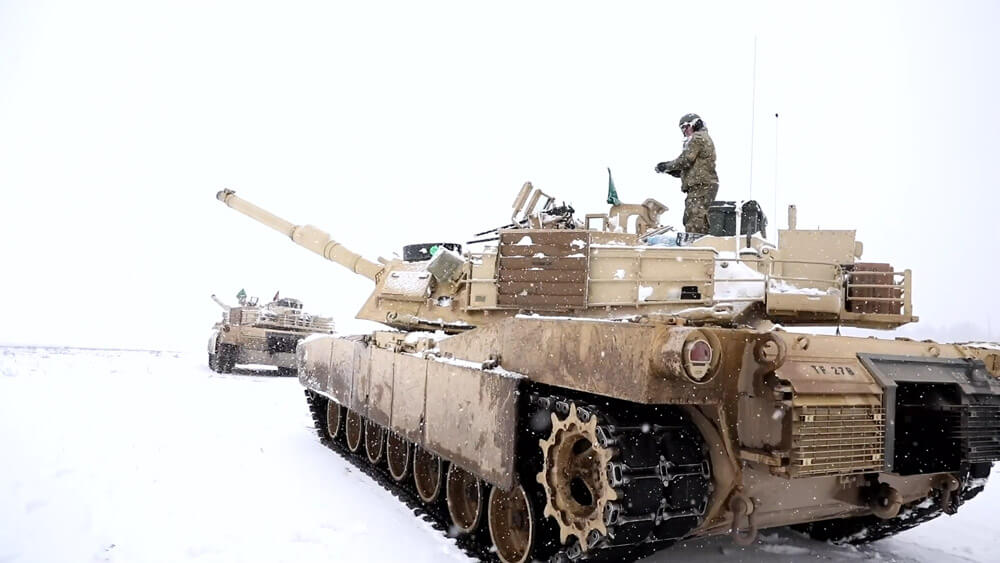 """Soldiers with """"Gunslinger"""" G Troop, 2nd Squadron, 278th Armored Cavalry Regiment, operate an Abrams Tank, January, 2019, as part of training during Operation Raider Lightning, a winter operations training event conducted while the 278th was deployed to Poland. Tennessee Army National Guard photo by SGT Arturo Guzman"""