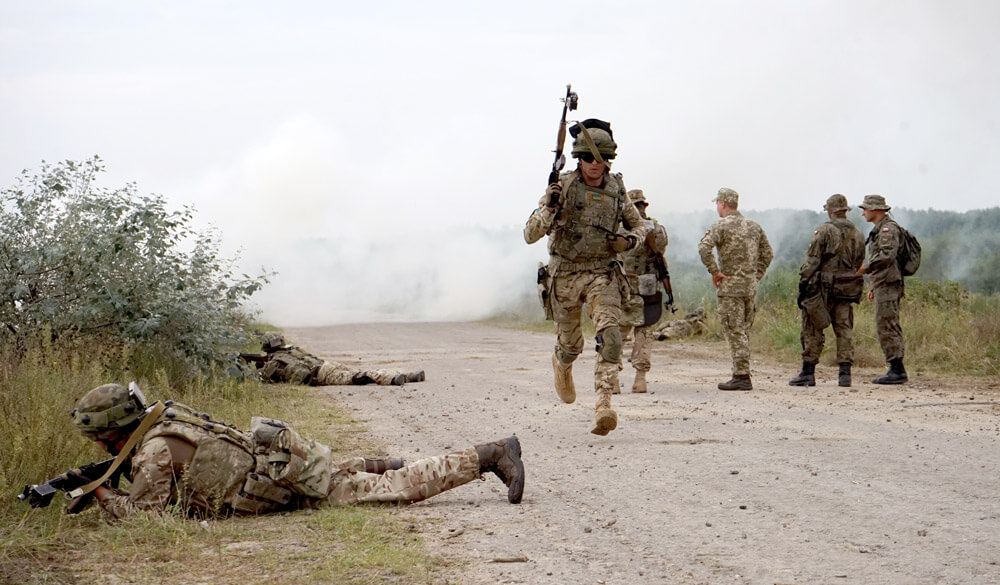 Ukrainian soldiers operate in a contact zone during a combat tactics exercise at the International Peacekeeping and Security Center in Yavoriv, Ukraine, as part of Exercise Rapid Trident, September, 2018. California Army National Guard photo by SPC Amy Carle