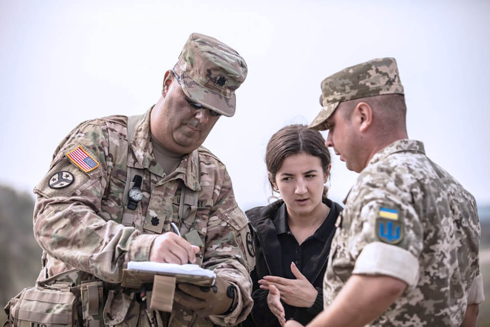 LTC Matthew Smith of the Tennessee Army National Guard briefs a Ukrainian soldier, via an interpreter, during Exercise Rapid Trident 18 held at the Yavoriv Combat Training Center, Ukraine. Tennessee Army National Guard photo by SGT Timothy Massey