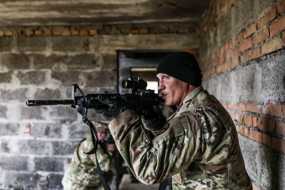 SGT Burton Holloway of Tennessee's 278th Armored Cavalry Regiment demonstrates room clearing procedures as part of a training event at the Yavoriv Combat Training Center, Ukraine, November 2018. Tennessee Army National Guard photo by SGT Timothy Massey