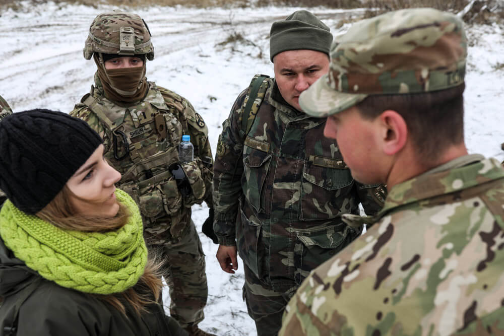 A NATO linguist translates for 278th Armored Cavalry Regiment Soldiers, 1LT Logan Shrum (second left) and 1LT Cruz Tomblin (far right) as they speak with a Ukrainian soldier during training at the Yavoriv Combat Training Center, Ukraine in November, 2018. Tennessee Army National Guard photo by SGT Timothy Massey
