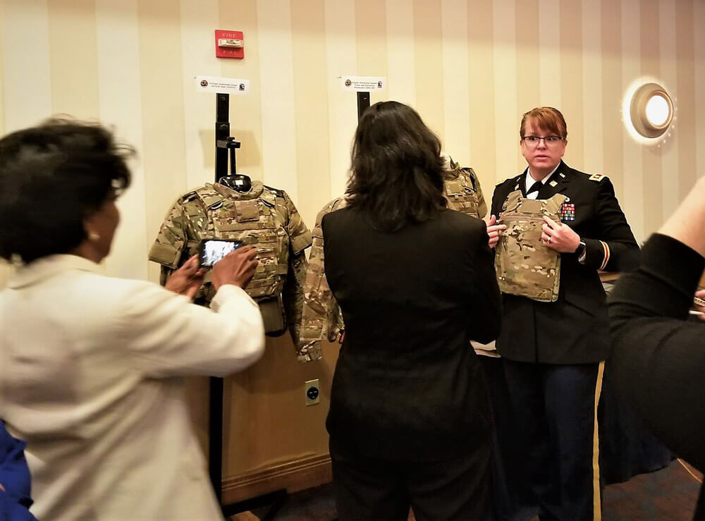 LTC Ginger Whitehead, product manager for Soldier Protection and Individual Equipment at PEO Soldier, shows members of the Defense Advisory Committee on Women in the Services some of the new Soldier Protection System's more female-friendly components. U.S. Army photo by Debra Dawson