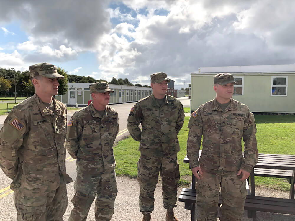 Oklahoma Army National Guard Soldiers (left to right) SPC Brandon Widman, SPC Durham Chilcoat, CPL Kyle Foor and SSG Jonathan Cody stand together while being briefed just after arrival to the Altcar Challenge 2018, an international military skills competition held at the Altcar Training Camp in Merseyside, England, and hosted by the United Kingdom Reserve Forces Association and the British Army Headquarters North West.