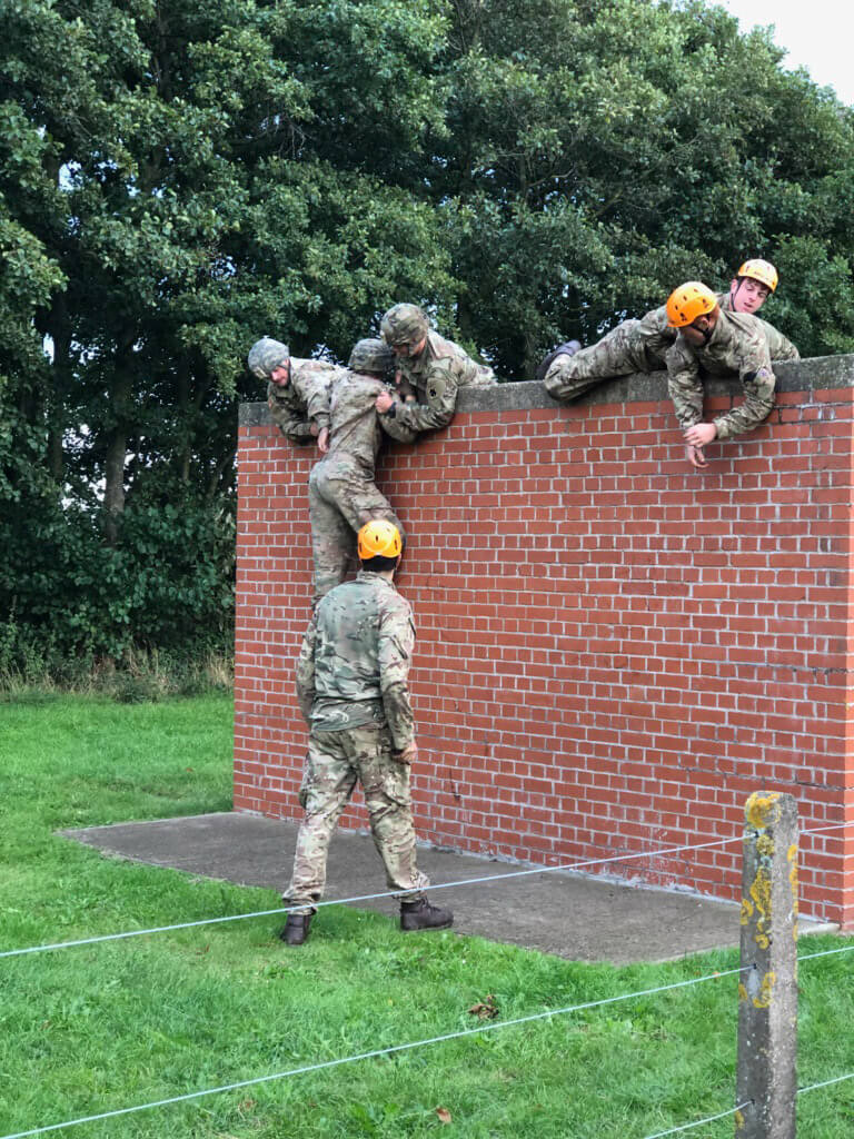 The Oklahoma Guard team members ensure no man is left behind as they run an obstacle course as part of a team event during the Altcar Challenge 2018.