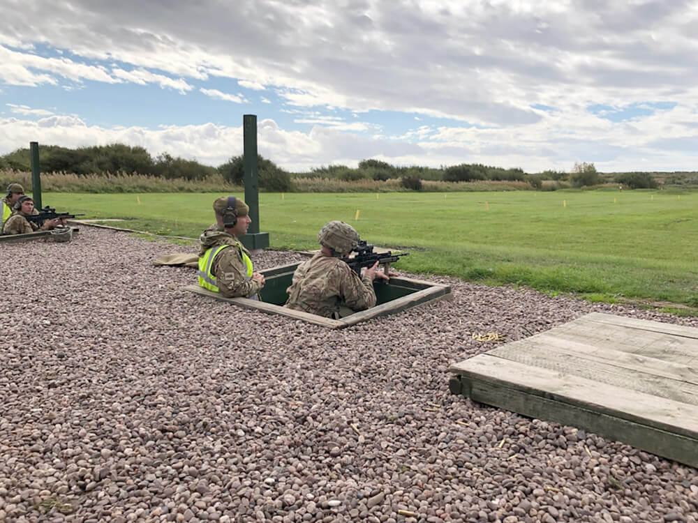 Two Altcar Challenge team members from Oklahoma's 45th Infantry Brigade Combat Team, shoot the SA80 NATO firearm on the weapons qualification range as part of a shooting event during the Altcar Challenge 2018.