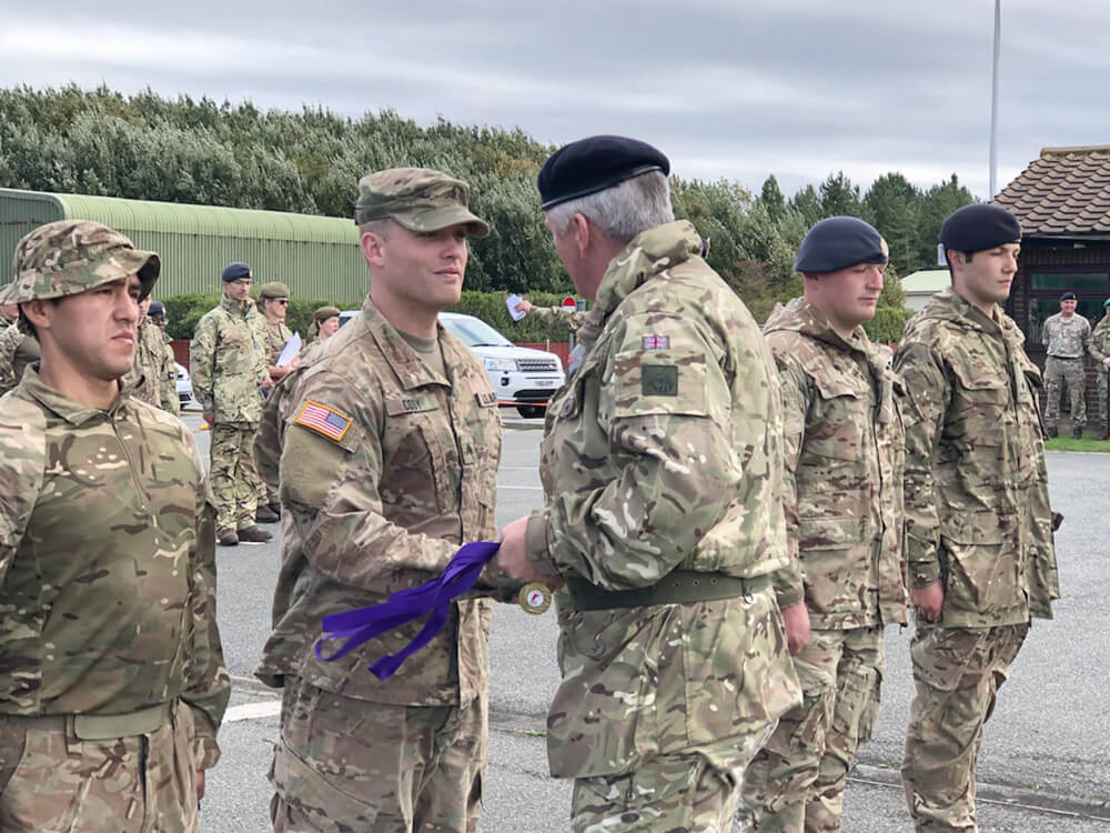 SGT Jonathan Cody of the 45th Infantry Brigade Combat Team, Oklahoma Army National Guard, accepts on behalf of his team the winning medal for the Altcar Challenge 2018 from Maj. Gen. William O'Leary, deputy commander of the British Field Army and joint head of the British Army Reserve, on Sept. 9, 2018.