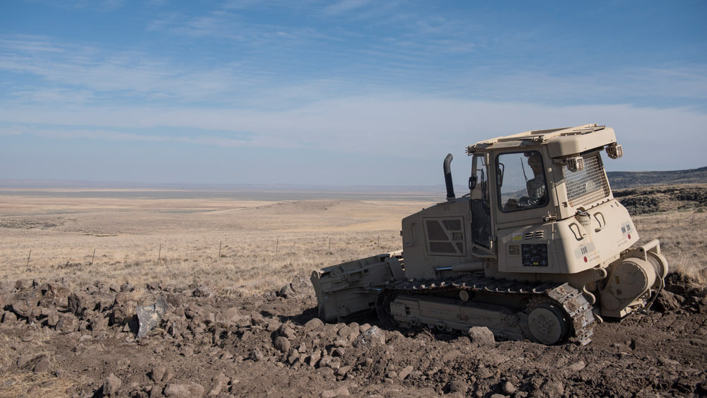 An Idaho Guard Soldier with the 166th Brigade Engineer Battalion uses a bulldozer to help repair a cattle road on the Duck Valley Indian Reservation as part of an Innovative Readiness Training program held September 2018. Idaho National Guard photo by TSgt John Winn