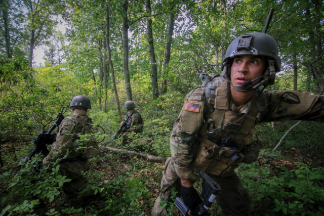 Army National Guard Soldiers from New Jersey's C Troop, 1st Squadron, 102nd Cavalry Regiment, move tactically through woods en route to an objective as part of a training mission on Joint Base McGuire-Dix-Lakehurst, N.J., June 2018. New Jersey National Guard photo by MSgt Matt Hecht