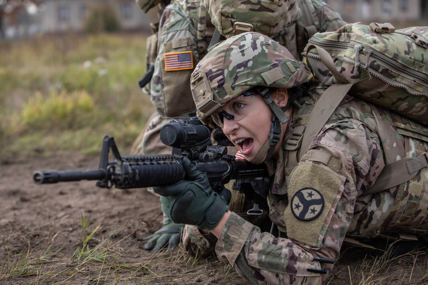 SPC Natalie Lajune, a combat medic with Battle Group Poland's Task Force Raider, directs her firing squad toward their next maneuver during a care under fire training exercise at Bemowo Piskie Training Area, Poland, October 2018. Task Force Raider is a detached forward element assigned with the Tennessee Army National Guard's 278th Armored Cavalry Regiment, headquartered out of Knoxville, Tenn. Tennessee Army National Guard photo by SGT Sarah Kirby