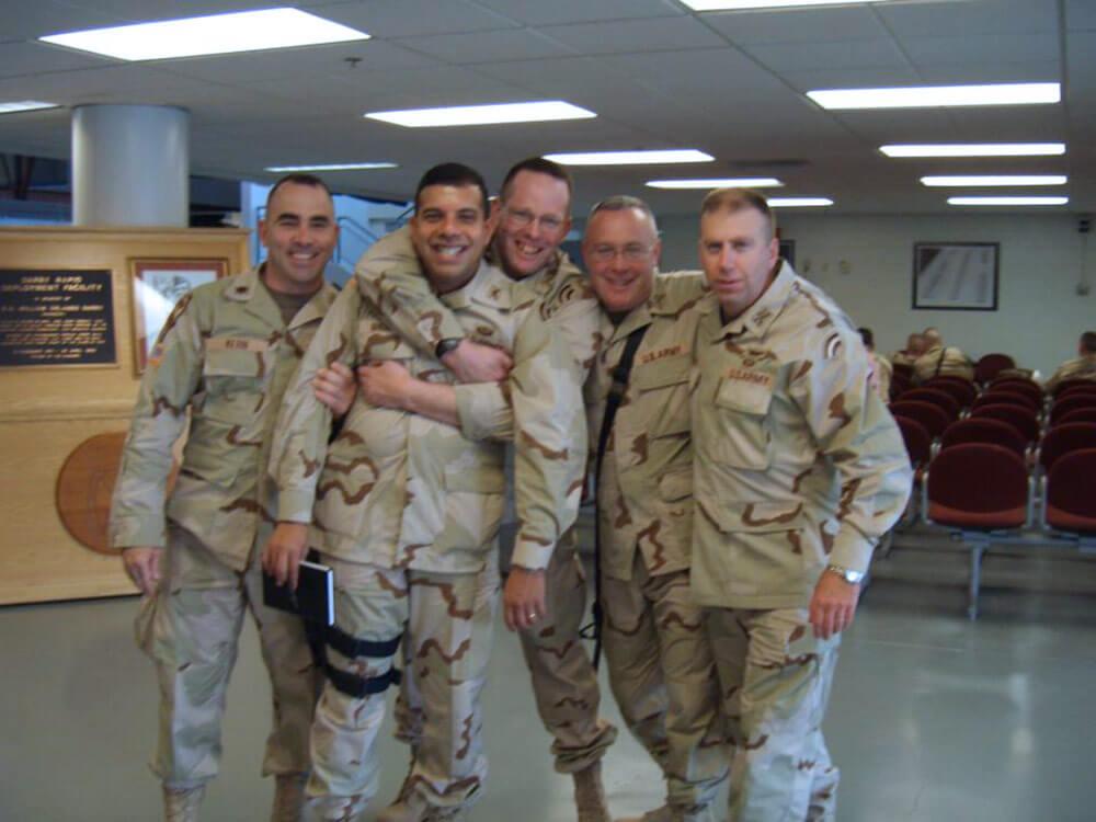 "Then-MAJ Albert Thiem, shown with fellow officers ""The Iron Majors,"" October 2004, in advance of a deployment to Iraq. Left to Right: MAJ Pat Kern, MAJ John Andonie, MAJ Jim Beagen, MAJ Pat Macklin, MAJ Albert Thiem. Photo courtesy CW3 Albert Thiem"