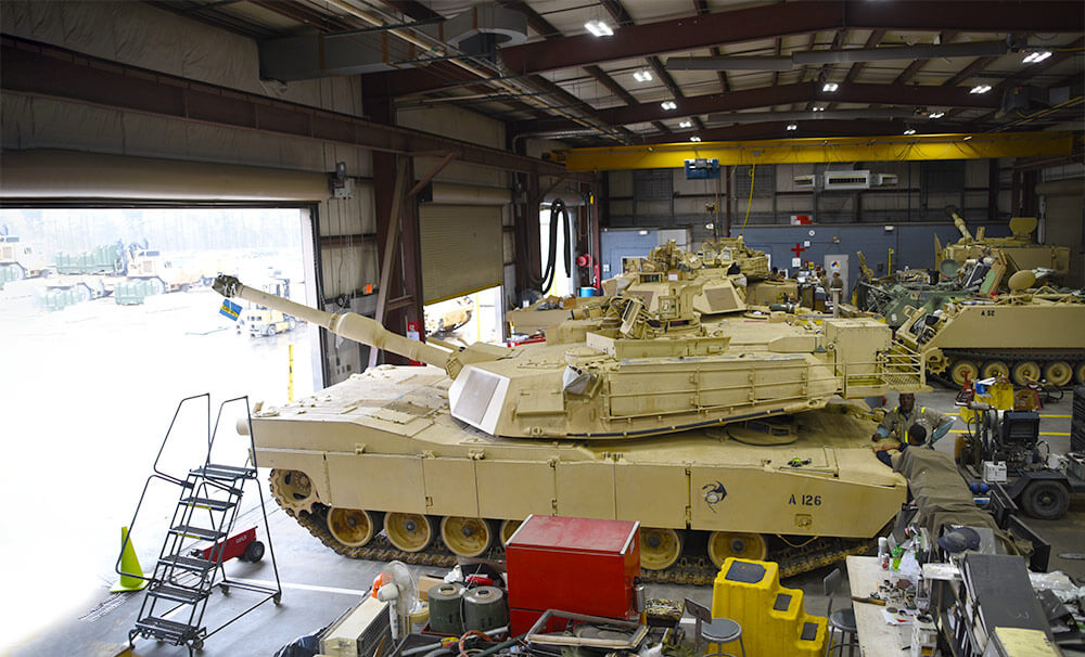 Dual-status technicians conduct vehicle maintenance and repairs on M1 Abrams tanks and other tracked vehicles in the maintenance bay at the South Carolina National Guard Unit Training Equipment Site on McCrady Training Center in Eastover, S.C. South Carolina Army National Guard photo by CPT Jessica Donnelly