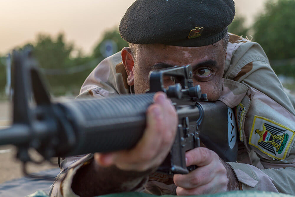 Iraqi soldier conducts dime/washer drills as part of a primary marksmanship instruction course led by Task Force India Bravo at Camp Taji, Iraq, December 2018. Mississippi Army National Guard photo by SPC Jovi Prevot
